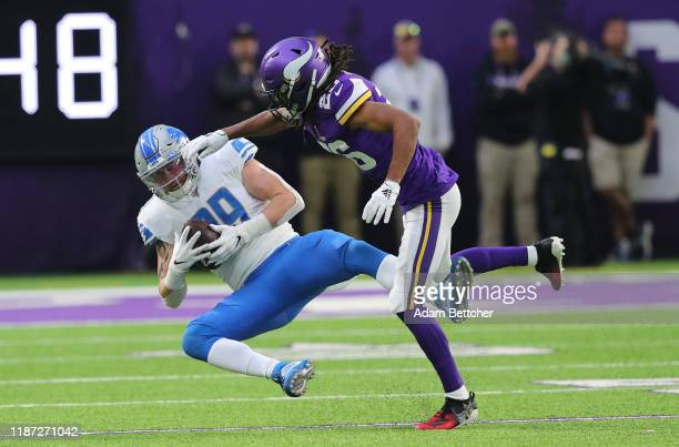 Isaac Nauta of the Detroit Lions catches a pass while Trae Waynes of the Minnesota Vikings attempts the tackle in the fourth quarter at U.S. Bank...