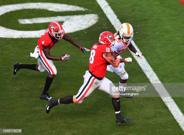 Isaac Nauta of the Georgia Bulldogs runs with a recovered fumble for a touchdown against the Tennessee Volunteers on September 29 2018 at Sanford...