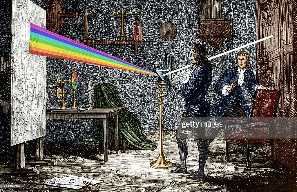 Isaac Newton (1642-1727) english mathematician, physicist and astronomer, author of the theory of terrestrial universal attraction, here dispersing light with a glass prism, engraving colorized document : News Photo