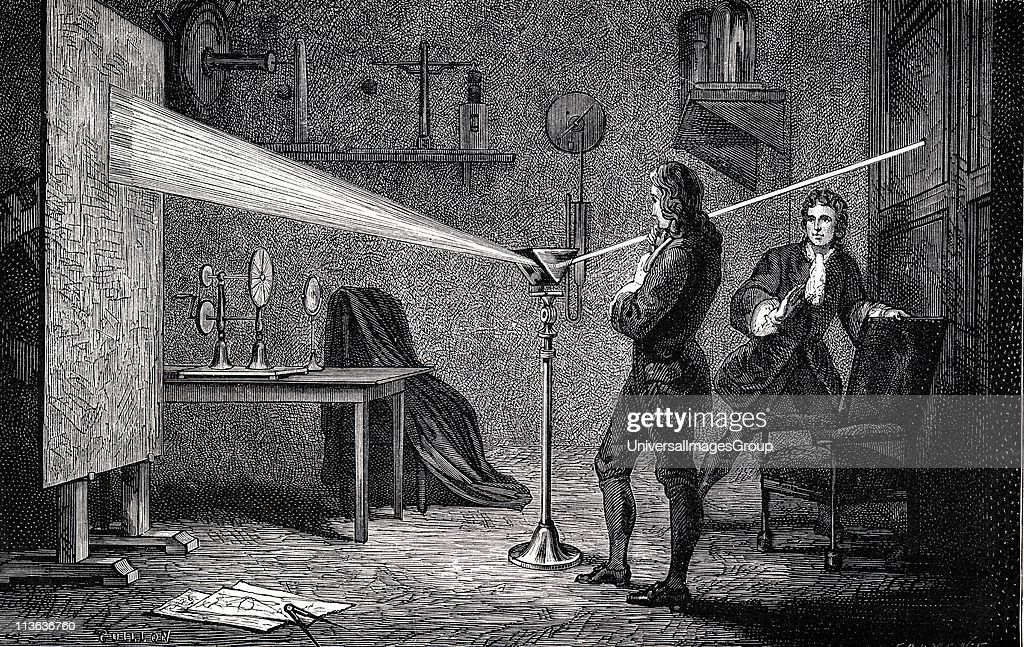 Image of Isaac Newton (1642-1727) English scientist and mathematician, using a prism to break white light into spectrum. With Cambridge room mate John Wickins. Engraving of 1874. Image credit : Getty Images.