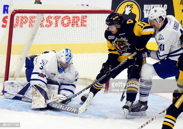 Isaac Nurse of the Mississauga Steelheads digs for a rebound against goalie Emanuel Vella and Nicolas Hague of the Mississauga Steelheads during game...