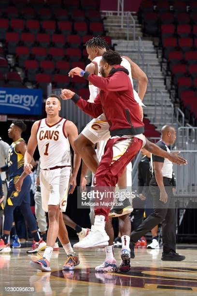 Isaac Okoro of the Cleveland Cavaliers celebrates with his teammates after hitting the winning shot against the Indiana Pacers on December 12, 2020...