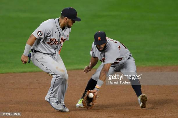 Isaac Paredes of the Detroit Tigers looks on as teammate Willi Castro fields the ball hit by Marwin Gonzalez of the Minnesota Twins during the sixth...