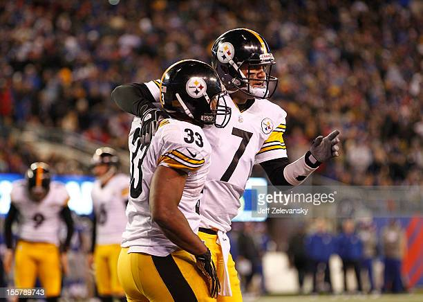 Isaac Redman and Ben Roethlisberger of the Pittsburgh Steelers celebrate a touchdown against the New York Giants during their game at MetLife Stadium...