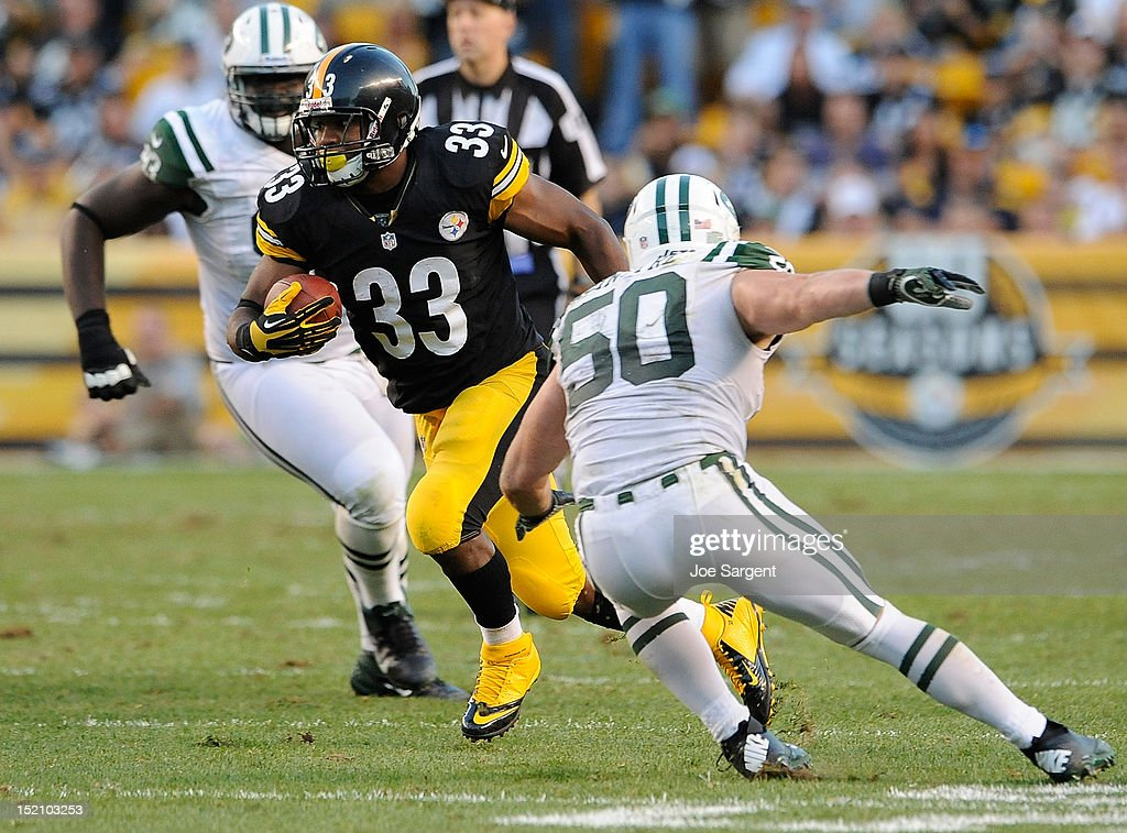 Isaac Redman #33 of the Pittsburgh Steelers carries the ball in front of Garrett McIntyre #50 of the New York Jets on September 16, 2012 at Heinz Field in Pittsburgh, Pennsylvania.