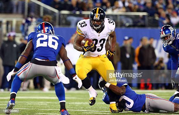 Isaac Redman of the Pittsburgh Steelers runs the ball against Prince Amukamara and Antrel Rolle of the New York Giants at MetLife Stadium on November...