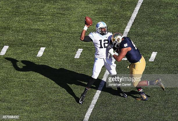 Isaac Rochell of the Notre Dame Fighting Irish pressures Marquise Williams of the North Carolina Tar Heels at Notre Dame Stadium on October 11, 2014...