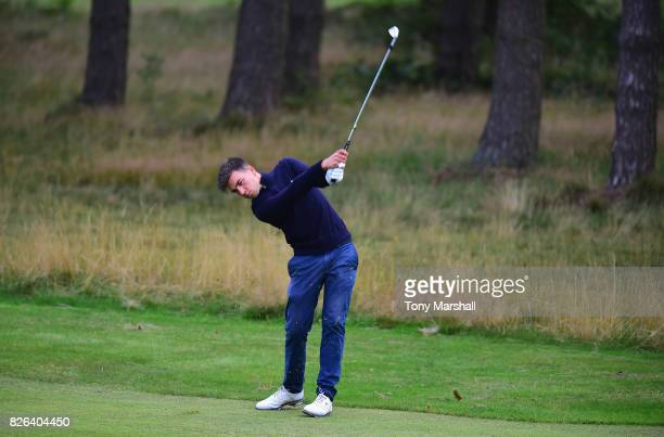 Isaac Simpson of Hallowes Golf Club plays his second shot on the 1st fairway during Day Three of the Galvin Green PGA Assistants' Championship at...