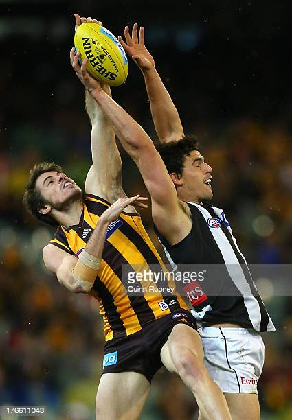 Isaac Smith of the Hawks and Scott Pendlebury of the Magpies contest for a mark during the round 21 AFL match between the Hawthorn Hawks and the...