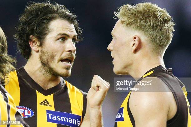 Isaac Smith of the Hawks argues with James Sicily at half time during the round five AFL match between the North Melbourne Kangaroos and the Hawthorn...