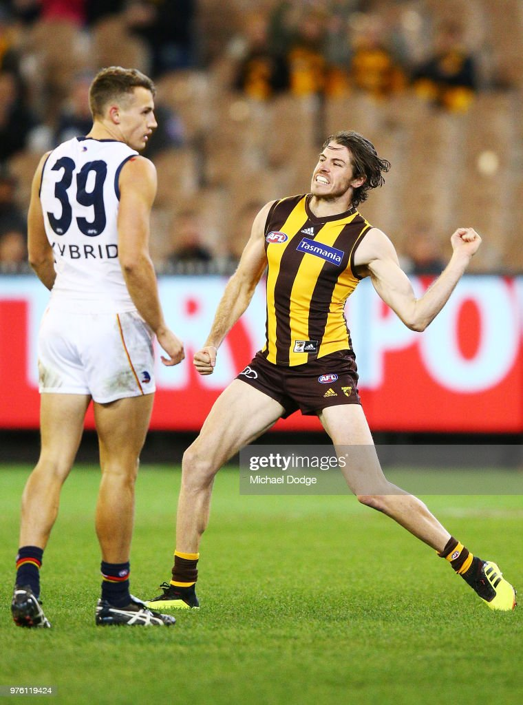Isaac Smith of the Hawks celebrates a goal against Tom Doedee of the Crows during the round 13 AFL match between the Hawthorn Hawks and the Adelaide Crows at Melbourne Cricket Ground on June 16, 2018 in Melbourne, Australia.