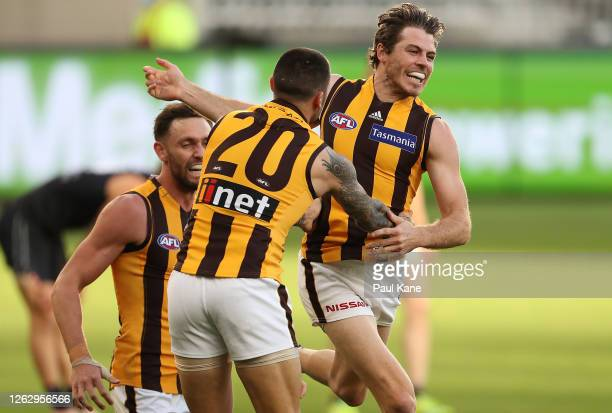 Isaac Smith of the Hawks celebrates a goal during the round nine AFL match between the Carlton Blues and the Hawthorn Hawks at Optus Stadium on July...
