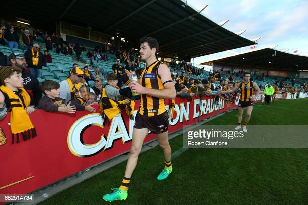 Isaac Smith of the Hawks celebrates with the fans after the Hawks defeated the Lions during the round eight AFL match between the Hawthorn Hawks and...