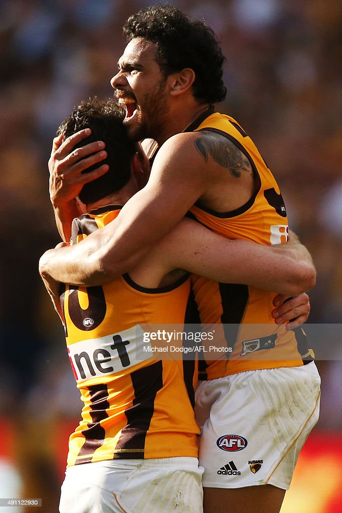 Isaac Smith of the Hawks (L) Cyril Rioli celebrate a goal during the 2015 AFL Grand Final match between the Hawthorn Hawks and the West Coast Eagles at Melbourne Cricket Ground on October 3, 2015 in Melbourne, Australia.