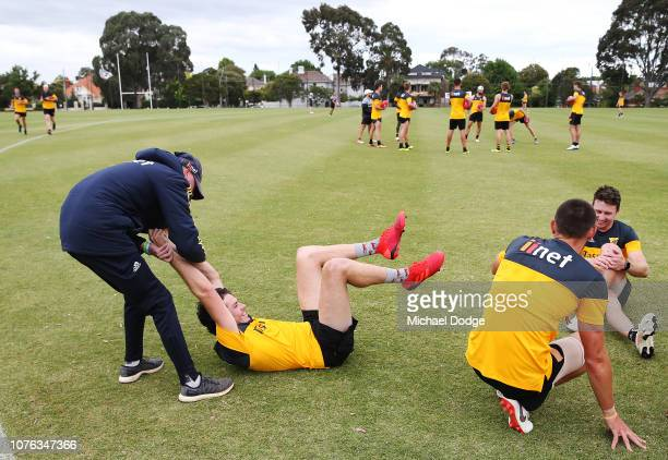 Isaac Smith of the Hawks is wrestled by a training assistant during a Hawthorn Hawks AFL training session at Xavier College on December 03 2018 in...