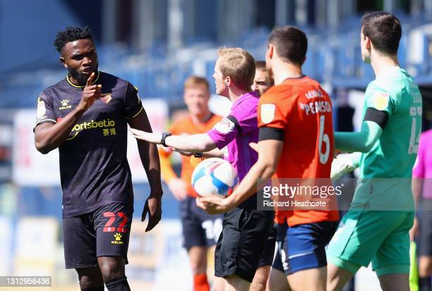 Isaac Success of Watford FC speaks with referee Gavin Ward during the Sky Bet Championship match between Luton Town and Watford at Kenilworth Road on...