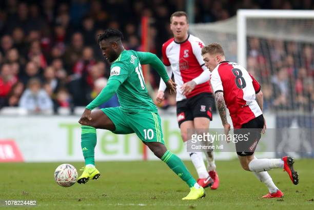 Isaac Success of Watford gets away from Harry Taylor of Woking during the FA Cup Third Round match between Woking and Watford at Kingfield Stadium on...
