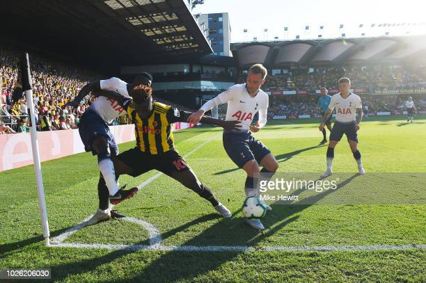 Isaac Success of Watford holds off Christian Eriksen and Davinson Sanchez of Tottenham Hotspur during the Premier League match between Watford FC and...