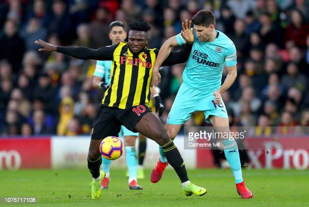 Isaac Success of Watford is challenged by Federico Fernandez of Newcastle United during the Premier League match between Watford FC and Newcastle...
