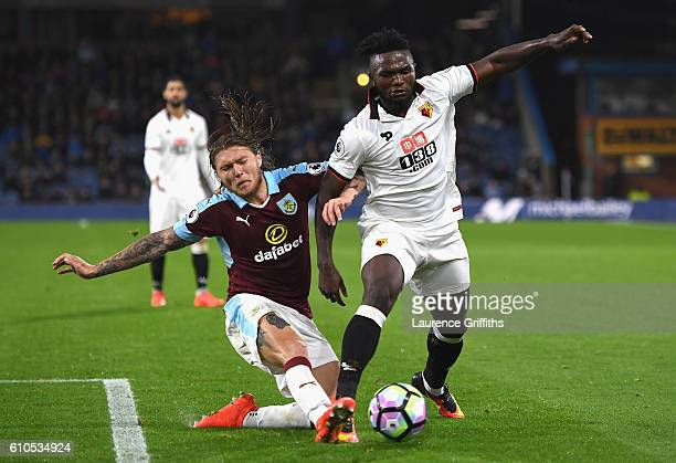 Isaac Success of Watford is tackled by Jeff Hendrick of Burnley during the Premier League match between Burnley and Watford at Turf Moor on September...