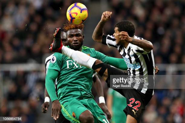 Isaac Success of Watford looks on as Deandre Yedlin of Newcastle United attempts to reach the ball during the Premier League match between Newcastle...