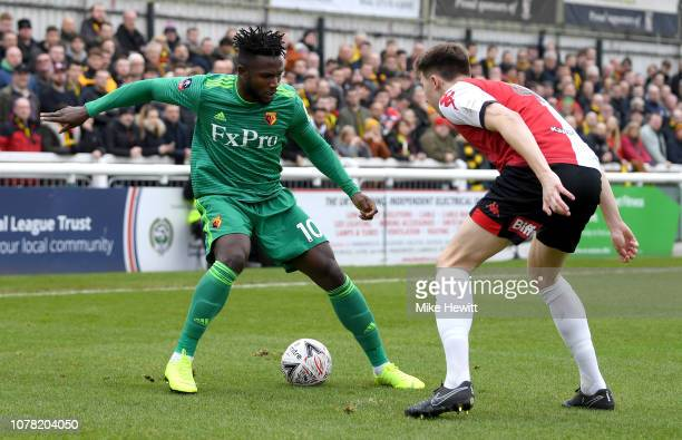 Isaac Success of Watford runs with the ball towards Jack Cook of Woking during the FA Cup Third Round match between Woking and Watford at Kingfield...