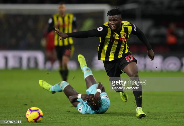 Isaac Success of Watford shakes off a tackle by Mohamed Diame of Newcastle United during the Premier League match between Watford FC and Newcastle...