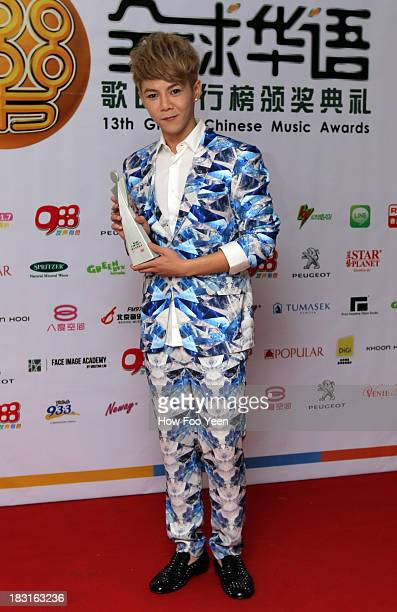 Isaac Teng of Malaysia poses with his Award of the Most Potential New Artiste during the 13th Global Chinese Music Awards at Putra Stadium on October...
