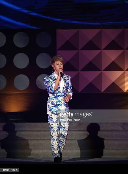 Isaac Teng of Malaysia sings during the 13th Global Chinese Music Awards at Putra Stadium on October 5 2013 in Kuala Lumpur Malaysia