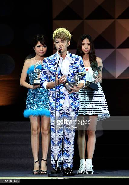 Isaac Teng of Malaysia speaks after he received his Awrad of the Most Potential New Artiste during the 13th Global Chinese Music Awards at Putra...