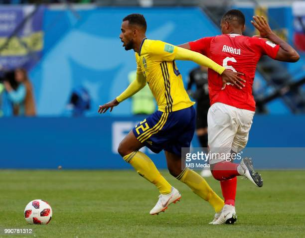 Isaac Thelin of Sweden national team and Manuel Akanji of Switzerland national team vie for the ball during the 2018 FIFA World Cup Russia Round of...