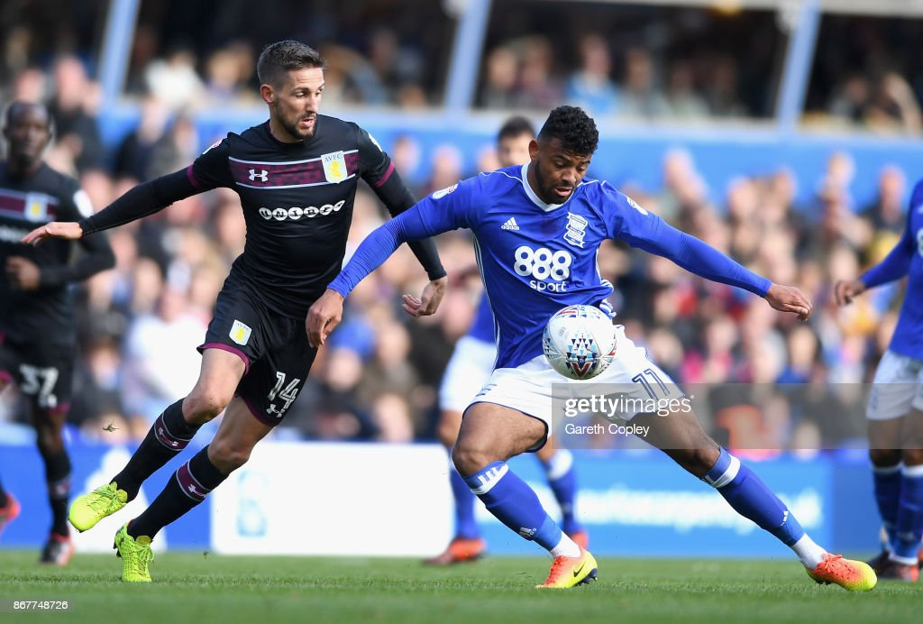 Isaac Vassell of Birmingham holds off Conor Hourihane of Aston Villa during the Sky Bet Championship match between Birmingham City and Aston Villa at St Andrews on October 29, 2017 in Birmingham, England.