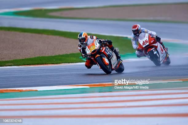 Isaac Vinales of Spain and Forward Racing Team rides followed by Tetsuta Nagashima of Japan and Idemitsu Honda Team Asia during the MotoGP of...