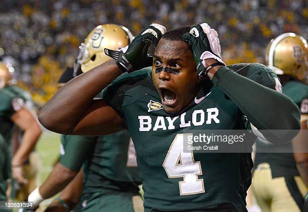 Isaac Williams of the Baylor Bears reacts after a touchdown in the fourth quarter during a game against the Oklahoma Sooners at Floyd Casey Stadium...