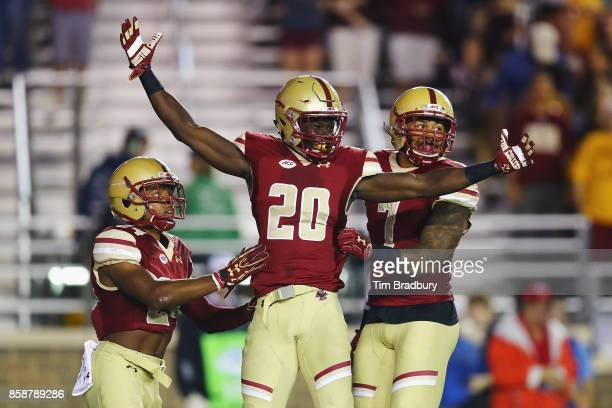 Isaac Yiadom of the Boston College Eagles celebrates after intercepting a pass during the first quarter against the Virginia Tech Hokies at Alumni...