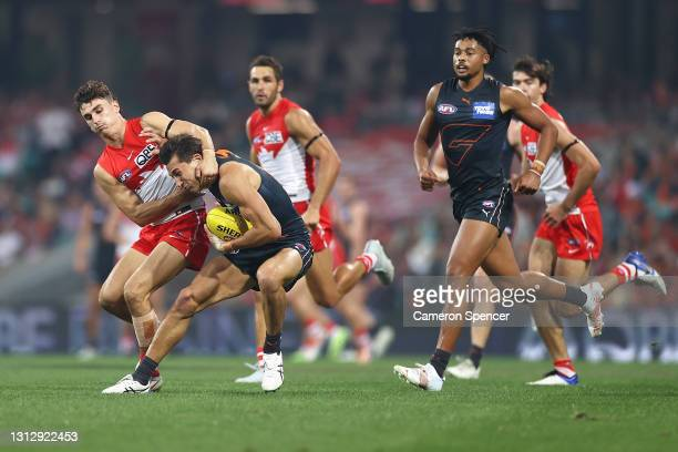 IsaacCumming of the Giants is tackled by Sam Wicks of the Swans during the round five AFL match between the Sydney Swans and the Greater Western...