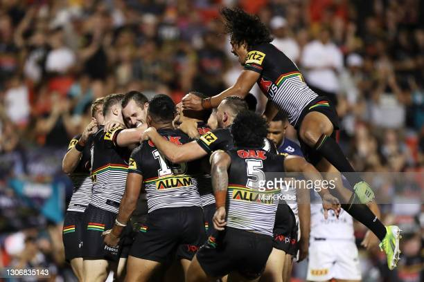 Isaah Yeo of the Panthers celebrates with his team mates after scoring a try during the round one NRL match between the Penrith Panthers and the...
