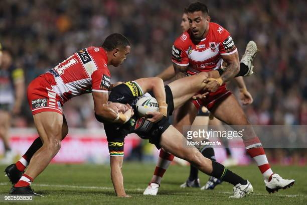 Isaah Yeo of the Panthers is tackled by Tyson Frizell and Paul Vaughan of the Dragons during the round 12 NRL match between the Penrith Panthers and...