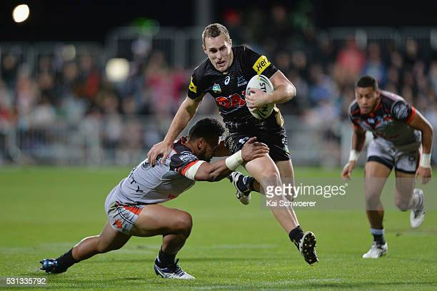 Isaah Yeo of the Panthers is tackled during the round 10 NRL match between the Penrith Panthers and the New Zealand Warriors at AMI Stadium on May 14...