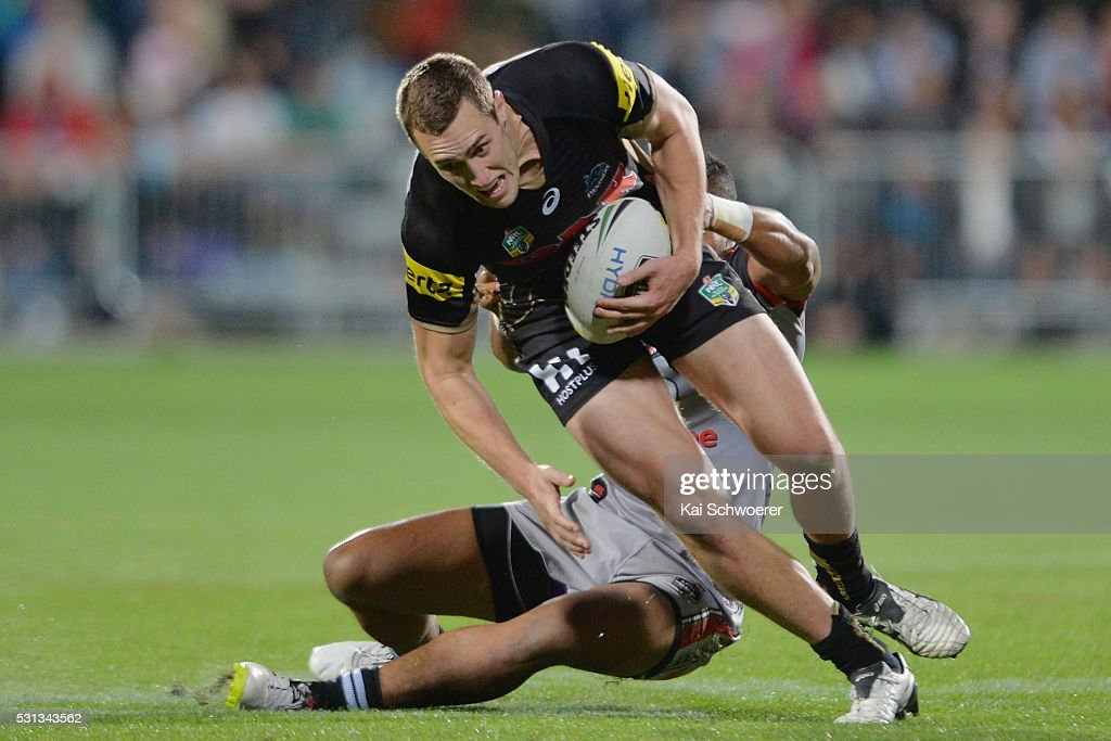 Isaah Yeo of the Panthers is tackled during the round 10 NRL match between the Penrith Panthers and the New Zealand Warriors at AMI Stadium on May 14, 2016 in Christchurch, New Zealand.