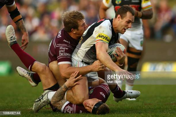 Isaah Yeo of the Panthers is tackled during the round 20 NRL match between the Manly Sea Eagles and the Penrith Panthers at Lottoland on July 28 2018...
