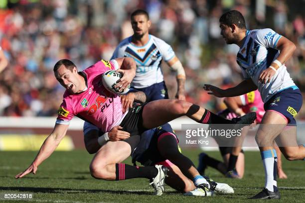 Isaah Yeo of the Panthers is tackled during the round 20 NRL match between the Penrith Panthers and the Gold Coast Titans at Pepper Stadium on July...