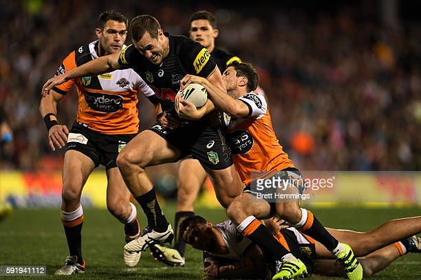 Isaah Yeo of the Panthers is tackled during the round 24 NRL match between the Penrith Panthers and the Wests Tigers at Pepper Stadium on August 19...
