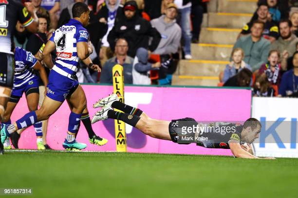 Isaah Yeo of the Panthers scores a try during the NRL round eight match between the Penrith Panthers and Canterbury Bulldogs on April 27, 2018 in...