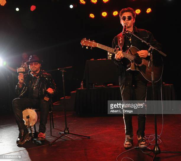 Isaak Presley performs with his dad at the SOS Pre Tour Launch Party held at The Roxy Theatre on June 2 2019 in West Hollywood California