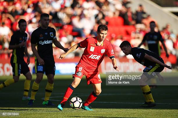 Isaas of Adelaide United runs with the ball during the round five ALeague match between Adelaide United and the Central Coast Mariners at Coopers...
