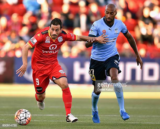 Isaas Sanchez of United and Mickael Tavares of Sydney compete for the ball during the round 10 ALeague match between Adelaide United and Sydney FC at...