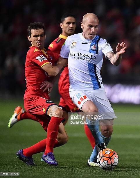 Isaas Sanchez of United competes for the ball with Aaron Mooy of Melbourne City during the ALeague Semi Final match between Adelaide United and...