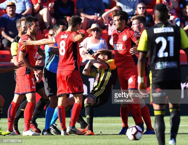 Isa'as S‡nchez of United and Armando Sosa Pena of the Phoenix compete during the round 11 ALeague match between Adelaide United and the Wellington...