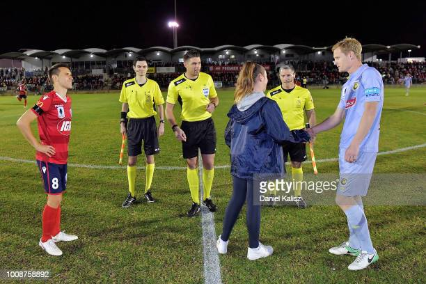 Isa'as S‡nchez of United and Matt Simon of the Mariners are pictured at the coin toss prior to the round of 32 FFA Cup match between Adelaide United...